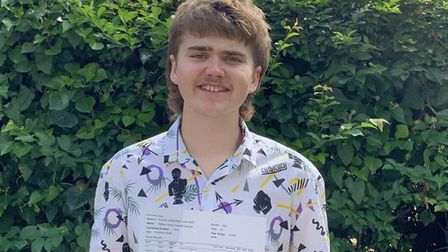 Will Daniels with his A Level results at Langley School. PHOTO: Langley School