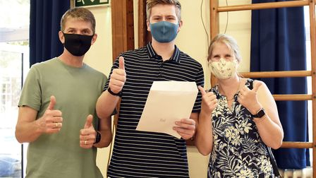Nathan Sutton with his parents at SET Beccles School on GCSE results day 2020. PHOTO: Charlotte Jame