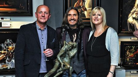 Lord and Lady Baker with Fabian Perez, centre, who donated to the auction.