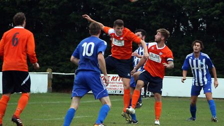 Diss v Godmanchester, Callum Webb heads clear as Diss defend in the second half.