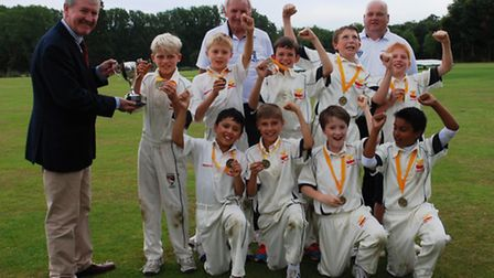Great Melton Under-11s celebrate their success with sponsor Damian Conway.