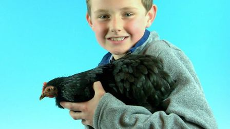 Charlie English with his Pekin Bantam chicken, Sarah. Picture: Rupert Stephenson, Poultry Photograph