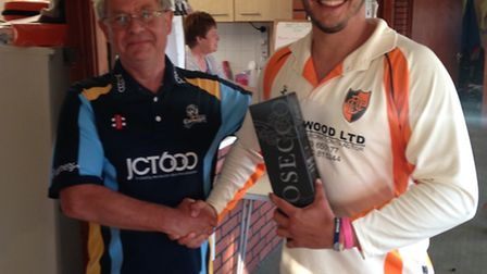Robbie West receives his man of the match award.