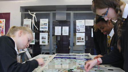 Pupils at Hartismere School helping to make the newly installed stained glass window