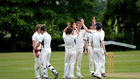 MCC ACTION: Youngsters celebrate a wicket at Wymondham College.