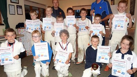 STARS OF FUTURE?: Guy McCurley with Great Meltons under-nine award winners.