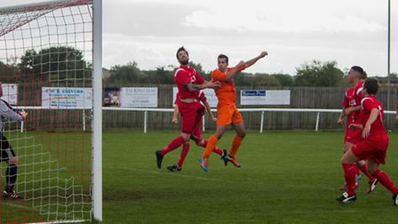 NEAR MISS: Mark Appleton goes close with a header for Diss at Ely. Photo: JOHN HUTTON