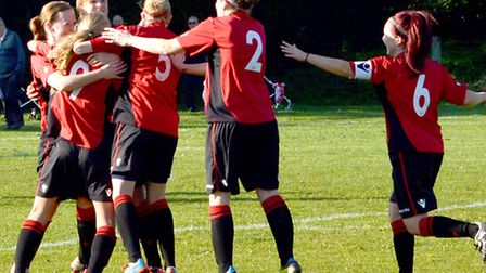 MAGIC MOMENT: Wymondham Ladies celebrate what proved to be the winner.
