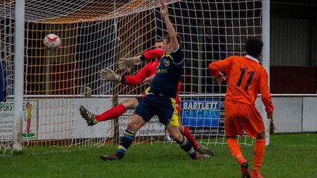 HEADING FOR VICTORY: Young Callum Olpin makes it 3-0 to Diss. Photo: John Hutton