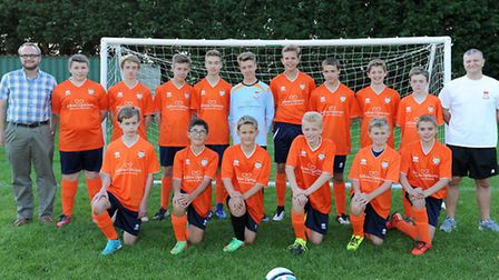HAPPY HAWKS: Diss Town Hawks Under-14s line up in their new kit, sponsored by Adkins Opticians Ltd.