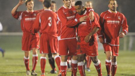 Lowestoft Town's Danny Cunningham, second right, is congratulated by Sam Gaughran after scoring the