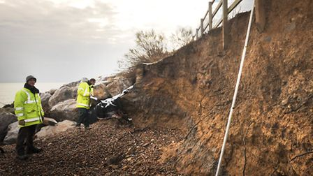 Coastal Erosion at East Lane, Bawdsey. Phil Usher and Mike Guymer investigating the situation.