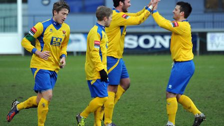 AFC Sudbury's James Baker (second from right) celebrates with his team-mates after scoring from a fi