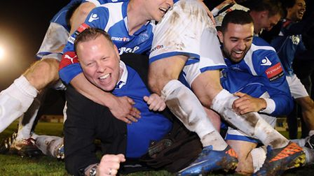 Leiston manager Mark Morsley, front left, is mobbed by his players after they won the Ryman League D