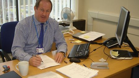 Tim Passmore at his desk as Police and Crime Commissioner.