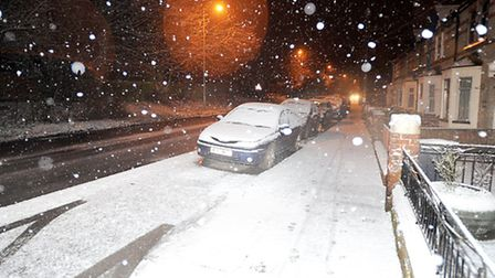 Heavy snow showers cause difficult driving conditions at rush hour on Needham Road, Stowmarket.