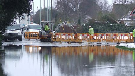 The area where High Road, Trimley St Martin, has flooded due to a burst water main today.