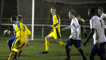 Action from Hadleigh United's victory over Oxhey Jets (yellow shirts) in the third round proper of t