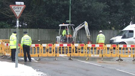 Work taking place to repair the burst water main in High Road, Trimley St Martin - the village has s