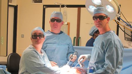 From left to right: Karen Tonks, ODP, and Mr Rowan Casey and Mr John Corr, consultant urological su