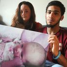 Chelsea Thompson and Todd Haynes hold a photo of their daughter Sarae Thompson-Haynes, who died from