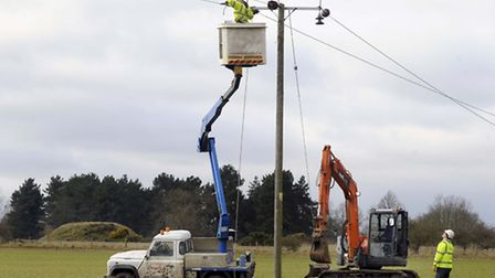 The over-head power cables which cross the Sutton Hoo AONB being taken down.