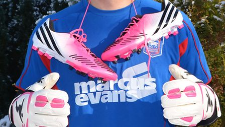 Ipswich Town goalkeeper Scott Loach has been wearing pink boots and gloves to raise money for a brea