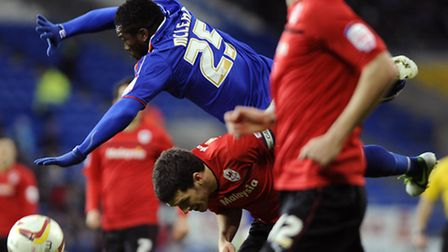 Aaron McLean falls over the back of Cardiff's Mark Hudson