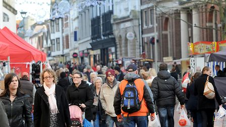 Shoppers fill the Cornhill area of Ipswich town centre preparing for Christmas.