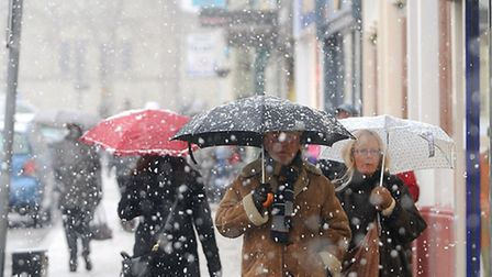 West Suffolk suffers from heavy snow showers. Shoppers in Bury St Edmunds struggle against the eleme