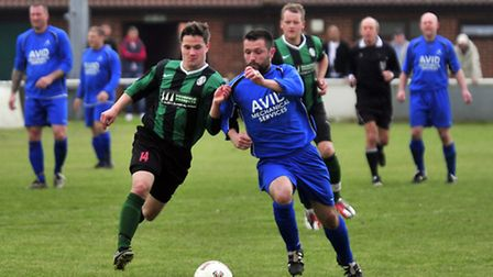 Action from last season's Bob Coleman Cup final between Achilles (blue shirts) and Haughley United a