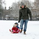People enjoying the snow in Christchurch Park in Ipswich. Neil pulls Barney (3) and Bella (1) on the