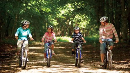 A family group cycling at Center Parcs