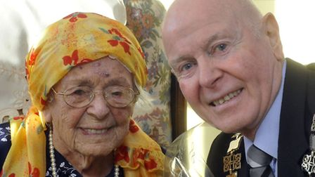 Barbara Allen, aged 100, the eldest survivor of the 1953 floods was presented with flowers by the M