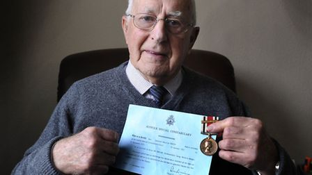 Ray Versey of Constable Road, Felixstowe, with his 25 years service medal from his time as a special