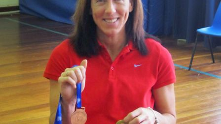 Wendy Smith with her medals at Bacton Community Middle School