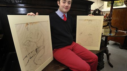 Auctioneer and valuer Jonathan Benson with two of the three Lucian Freud Sketches dating from the 19