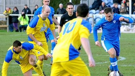 Brantham Athletic goalscorer Dave Grimwood tries to wriggle clear of the Whitley Bay defence
