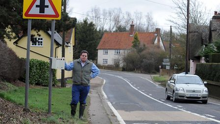 Wickhambrook resident Sam Sykes with his radar box on the A143.
