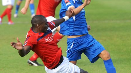 Bury Town's Lee Reed, right, being tackled by Hampton & Richmond Borough's Darren Powell