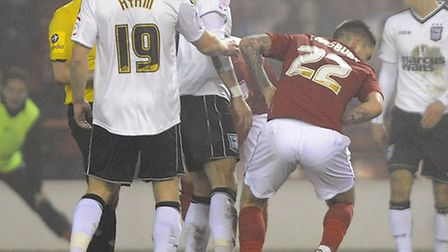 Henri Lansbury goes down clutching his stomach after a tangle with Lee Martin for which the Town pla
