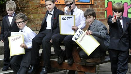 Sir Robert Hitcham's Primary School Pupils, Framlingham dressed as 007 for world book day. Left to r