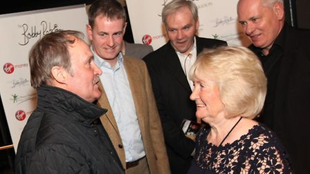 Former Ipswich Town and England captain Mick Mills is greeted by Lady Elsie, widow of Sir Bobby Robs