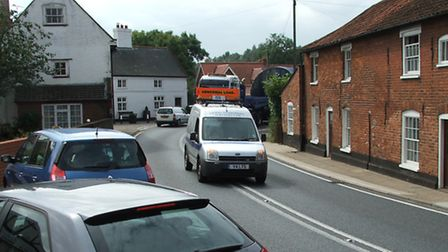 A wide load makes its way through the Farnham bend on the A12.