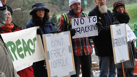 Campaigners from Greenpeace hold a demonstration the use of fracking to obtain gas