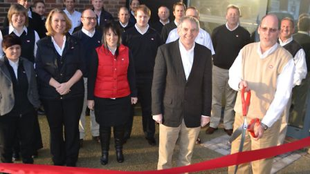 Jerry Moye [right], Cobb president, cuts the ribbon at the opening of the new offices,