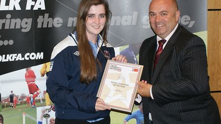 Kelly Scrutton, Young Volunteer of the Year, receiving her award from former Suffolk FA County chai