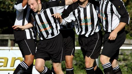 The SIL Representative side celebrate a goal against the Reading League in last season's competition