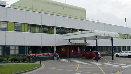A woman has been take to Colchester General Hospital after a two-car crash