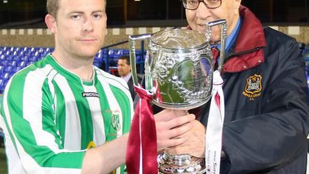 Whitton United captain Robbie Knott, left, receives the Suffolk Senior Cup from Suffolk FA president